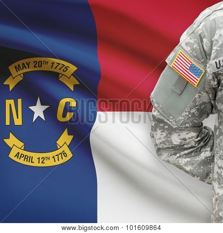 American Soldier With Us State Flag On Background - North Carolina