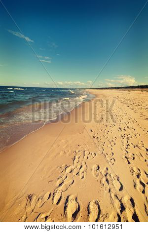 Baltic sea beach with many footstep, Poland.