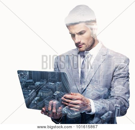 Double exposure of a businessman and a city using a laptop