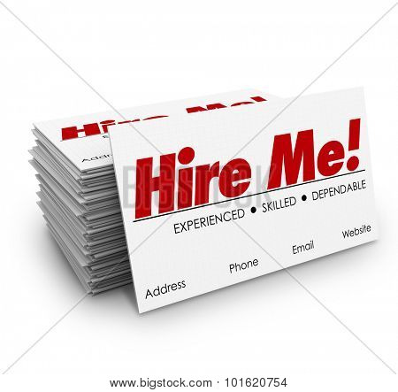 Hire Me words on a stack of business cards to sell or promote yourself as a great candidate for a job or open position