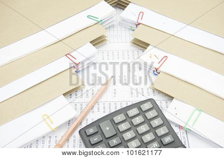 Pencil And Calculator Between Stack Paperwork Report With Envelope