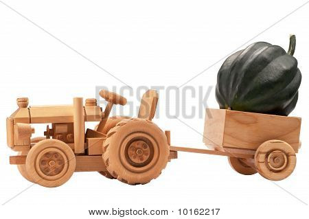 Toy Tractor With Green Pumpkin.