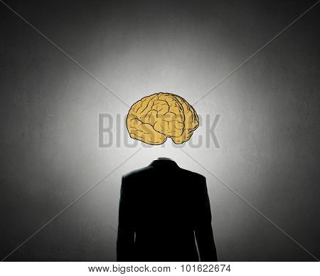 Businessman in suit with brain instead of head