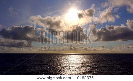 View Of The Setting Sun Over The Pacific Ocean From The Deck Of A Cruise Ship At Sea