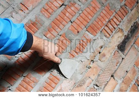 Spatula On A Brick Wall Background