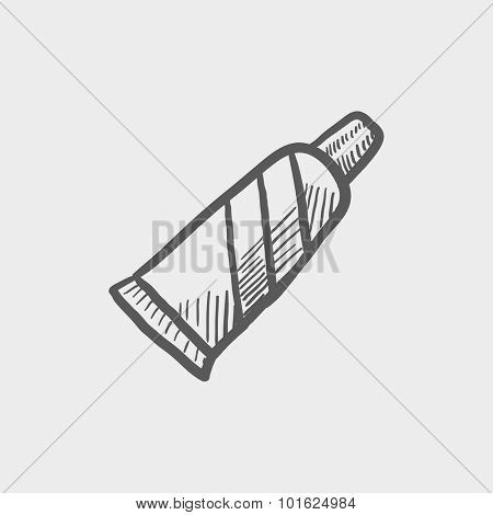 Tube of toothpaste sketch icon for web, mobile and infographics. Hand drawn vector dark grey icon isolated on light grey background.