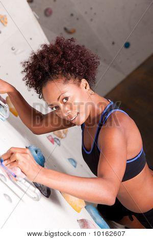 Woman at the climbing wall