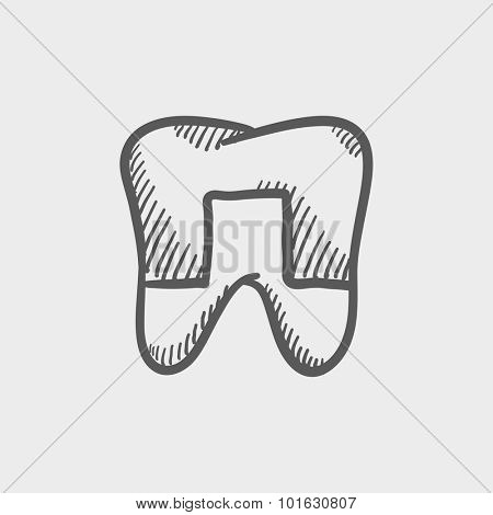 Crowned tooth sketch icon for web, mobile and infographics. Hand drawn vector dark grey icon isolated on light grey background.
