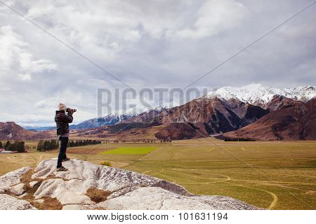 Photographer Standing And Take A Photo On Rock Cliff At Castle Hill South Island New Zealand Beautif