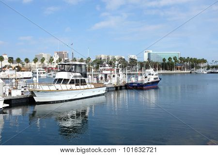 LONG BEACH, CA - FEBRUARY 21, 2015: Boats at Rainbow Harbor. Rainbow Harbor is a popular Southern California Destination of tourist and locals.