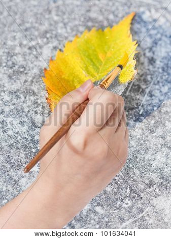Paintbrush Paints Fallen Leaf In Yellow Colour