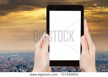 Tablet Pc With Cut Out Screen And Smog Over City