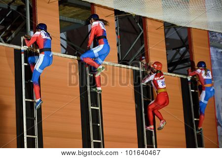 ST. PETERSBURG, RUSSIA - SEPTEMBER 7, 2015: Semi-final female race in the rise of a hook ladder during the XI World Championship in Fire and Rescue Sport. First World Championship was held in 2002