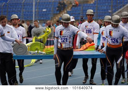 ST. PETERSBURG, RUSSIA - SEPTEMBER 9, 2015: Team Germany bring fire hoses before competitions in combat deployment during XI World Championship in Fire and Rescue Sport