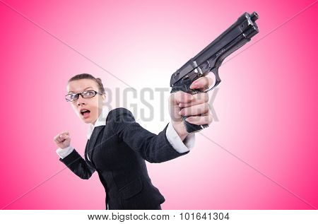 Woman with gun isolated on white