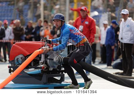 ST. PETERSBURG, RUSSIA - SEPTEMBER 9, 2015: Team Russia during competitions in combat deployment during the XI World Championship in Fire and Rescue Sport. First World Championship was held in 2002