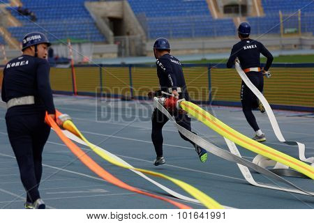 ST. PETERSBURG, RUSSIA - SEPTEMBER 9, 2015: Team Korea during competitions in combat deployment during the XI World Championship in Fire and Rescue Sport. First World Championship was held in 2002