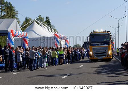 NOVOPRIOZERSK HIGHWAY, LENINGRAD OBLAST, RUSSIA - SEPTEMBER 11, 2015: First trucks passing on the new stretch of Novopriozersk highway. Construction began in 2013