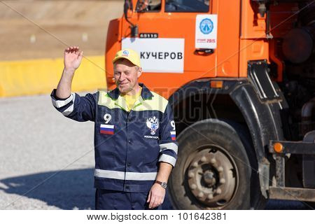 NOVOPRIOZERSK HIGHWAY, LENINGRAD OBLAST, RUSSIA - SEPTEMBER 11, 2015: Participant of truck competitions during the final of Worldskills Russia championship among road workers
