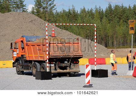 NOVOPRIOZERSK HIGHWAY, LENINGRAD OBLAST, RUSSIA - SEPTEMBER 11, 2015: Truck competitions during the final of Worldskills Russia championship among road workers