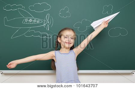 girl drawing plane on school board