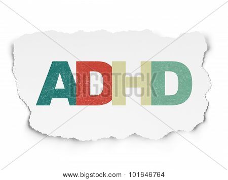 Medicine concept: ADHD on Torn Paper background