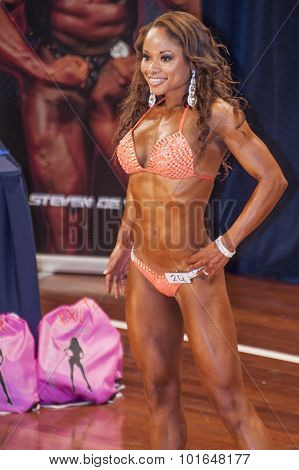 Female Fitness Model Shows Het Best Side In Competition