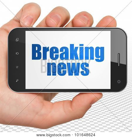 News concept: Hand Holding Smartphone with Breaking News on display