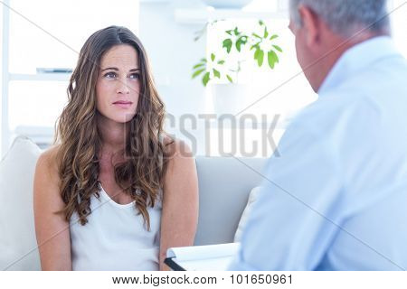 Psychiatrist advising female patient at home