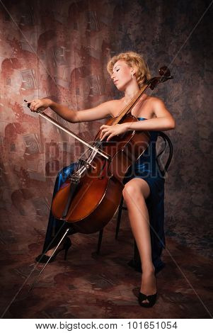 Beauty Woman In Evening Dress Playing Cello