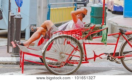 Relax Man On Pedicab Background.