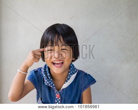 Portrait Of Cute Little Asian Girl With Toothy Smile