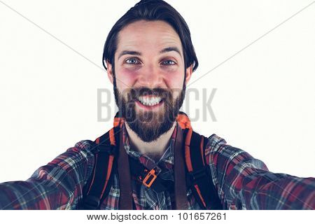 Portrait of happy hiker against white background