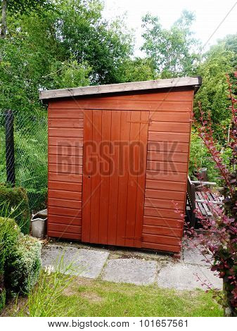 garden shed in a green luscious garden blooming growing