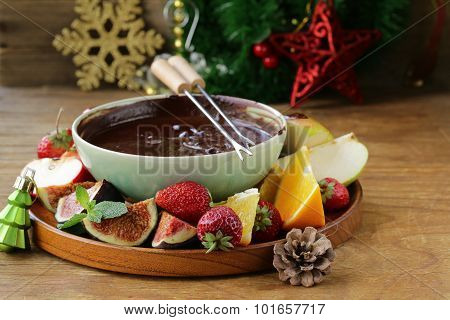 Christmas dessert chocolate fondue with various fruits