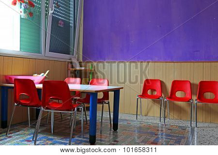 Classroom With Desks And Red Chairs