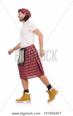 Scotsman in movement isolated on white