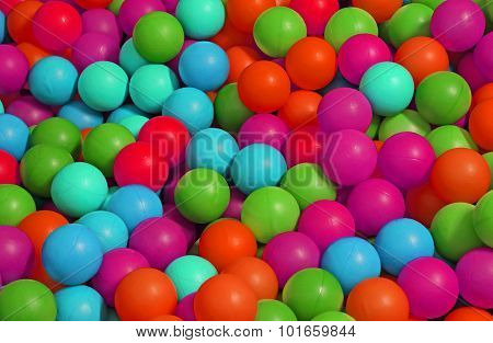 Background Of Many Colored Plastic Balls In A Pool