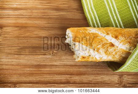 Baguette and green kitchen towel