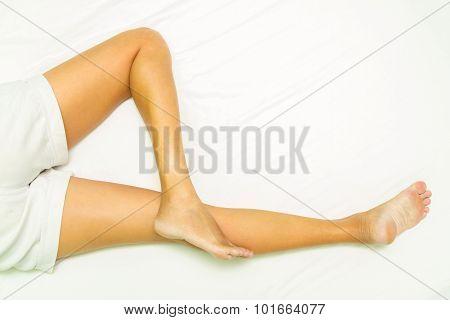 Slim Legs Of Women On White Background.