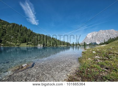 idyllic mountain lake at austrian alps with blue sky
