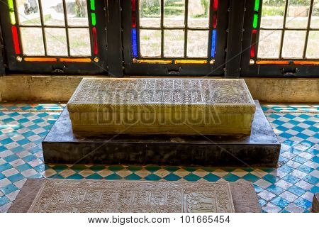 Marble grave by the windows