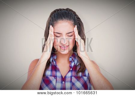 Upset woman suffering from headache against grey background with vignette