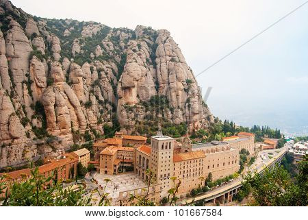 Santa Maria De Montserrat Abbey In Monistrol De Montserrat, Catalonia, Spain. Famous For The Virgin