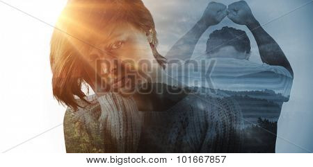 Upset man leaning on white background against trees and mountain range against cloudy sky