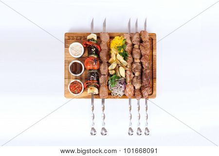 assorted kebabs on a board white background, food, barbecue