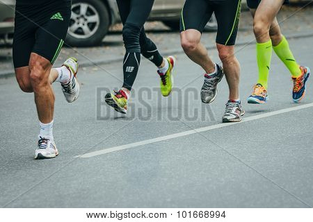 group of joggers running down the street