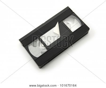 VHS Video cassette tape with half peeled or curled label, isolated on white. top view.