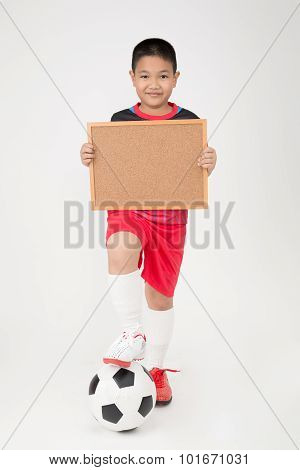 Little Asian Boy Holding Empty Wood Board In Sport Uniform