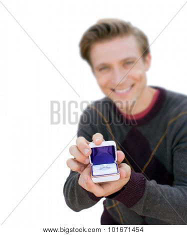 Man kneeling down and proposing - focus on ring isolated on white